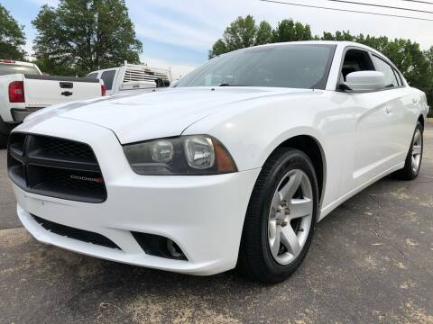 2013 Dodge Charger for sale at Capital Motors in Raleigh NC