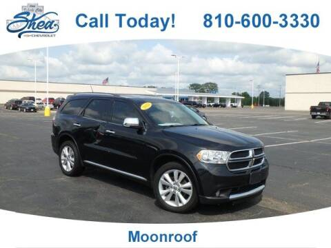 2013 Dodge Durango for sale at Erick's Used Car Factory in Flint MI