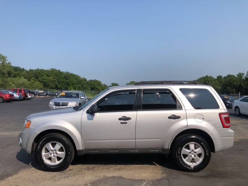 2009 Ford Escape for sale at CARS PLUS CREDIT in Independence MO