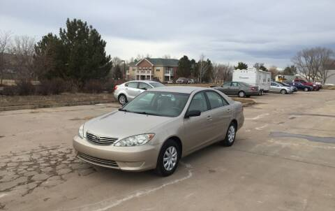 2005 Toyota Camry for sale at QUEST MOTORS in Englewood CO