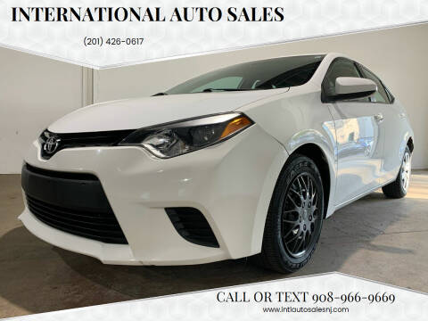 2014 Toyota Corolla for sale at International Auto Sales in Hasbrouck Heights NJ