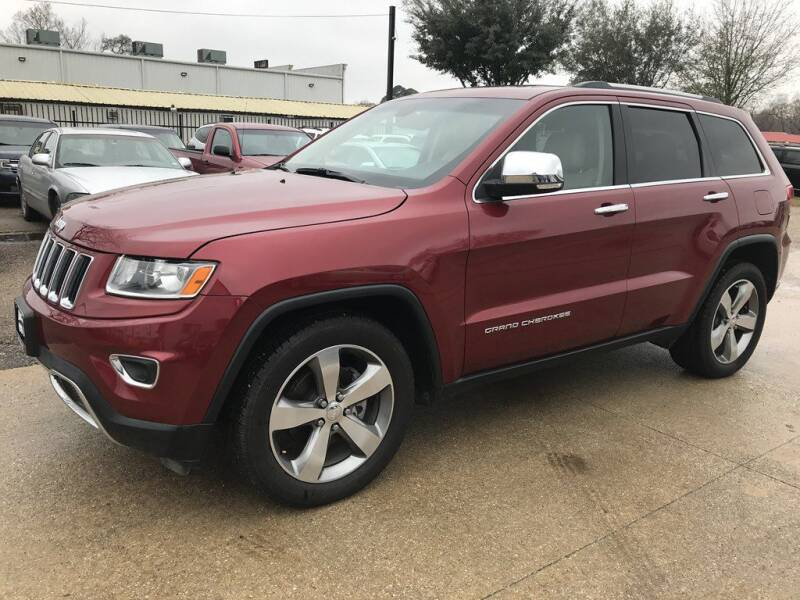 2014 Jeep Grand Cherokee for sale at AMIGO USED CARS in Houston TX