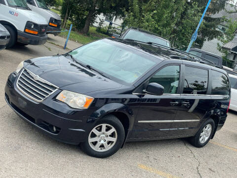 2010 Chrysler Town and Country for sale at Exclusive Auto Group in Cleveland OH