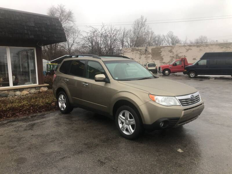 2009 Subaru Forester for sale at BELL AUTO & TRUCK SALES in Fort Wayne IN