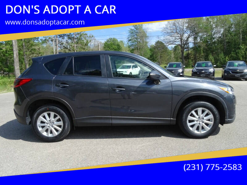 2016 Mazda CX-5 for sale at DON'S ADOPT A CAR in Cadillac MI
