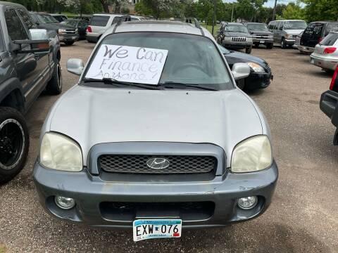 2004 Hyundai Santa Fe for sale at Continental Auto Sales in White Bear Lake MN