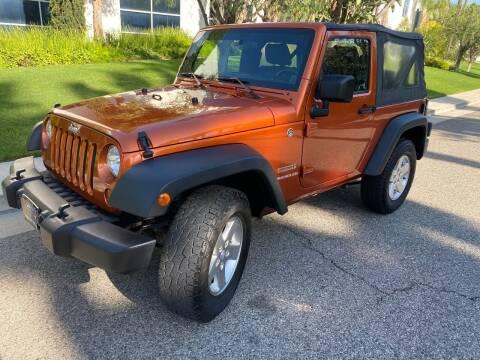 2011 Jeep Wrangler for sale at Donada  Group Inc in Arleta CA