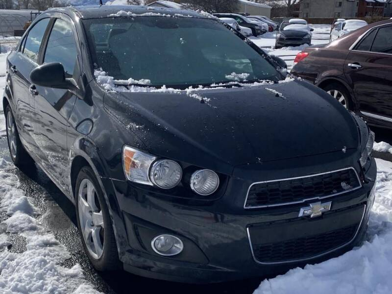 2013 Chevrolet Sonic for sale at INVICTUS MOTOR COMPANY in West Valley City UT