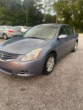 2010 Nissan Altima for sale at WIGGLES AUTO SALES INC in Mableton GA