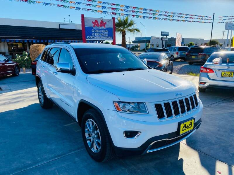 2014 Jeep Grand Cherokee for sale at A AND A AUTO SALES in Gadsden AZ