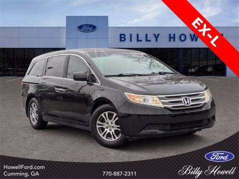 2012 Honda Odyssey for sale at BILLY HOWELL FORD LINCOLN in Cumming GA