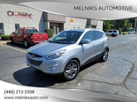 2015 Hyundai Tucson for sale at Melniks Automotive in Berea OH