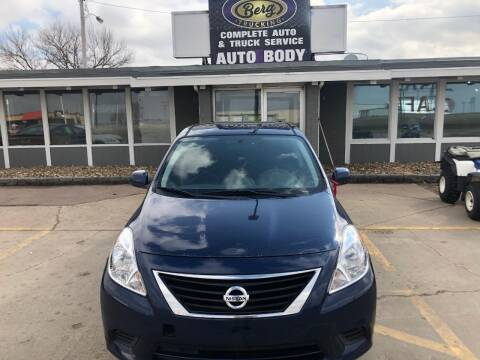 2014 Nissan Versa for sale at BERG AUTO MALL & TRUCKING INC in Beresford SD