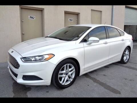 2014 Ford Fusion for sale at Selective Motor Cars in Miami FL