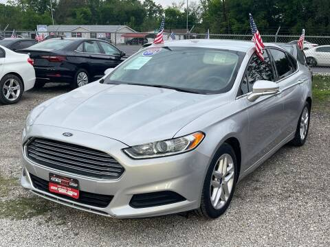 2016 Ford Fusion for sale at Premium Auto Group in Humble TX