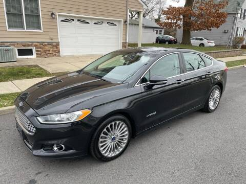 2014 Ford Fusion Hybrid for sale at Jordan Auto Group in Paterson NJ