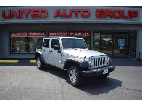 2009 Jeep Wrangler Unlimited for sale at United Auto Group in Putnam CT