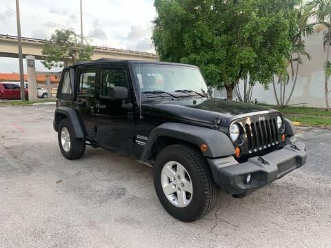 2010 Jeep Wrangler Unlimited for sale at MIAMI FINE CARS & TRUCKS in Hialeah FL