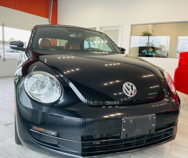2015 Volkswagen Beetle Convertible for sale at Evolution Autos in Whiteland IN