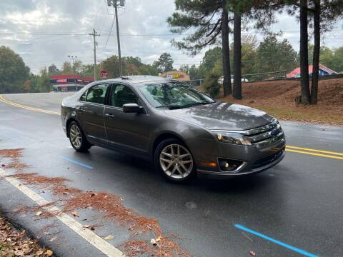2012 Ford Fusion for sale at THE AUTO FINDERS in Durham NC