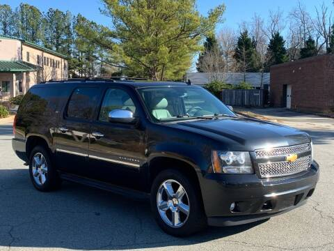 2012 Chevrolet Suburban for sale at Triangle Motors Inc in Raleigh NC