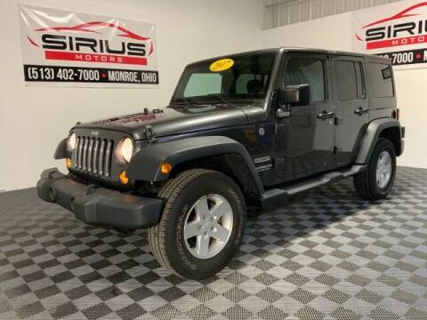 2017 Jeep Wrangler Unlimited for sale at SIRIUS MOTORS INC in Monroe OH
