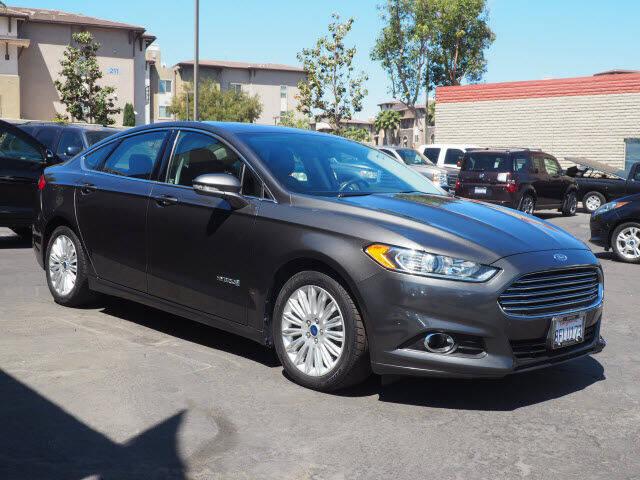 2015 Ford Fusion Hybrid for sale at Corona Auto Wholesale in Corona CA