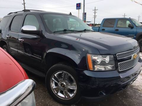 2009 Chevrolet Tahoe for sale at BARNES AUTO SALES in Mandan ND