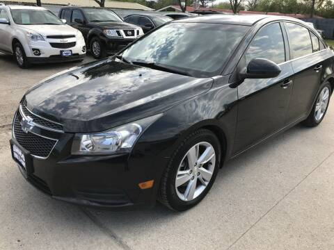 2014 Chevrolet Cruze for sale at AMIGO USED CARS in Houston TX