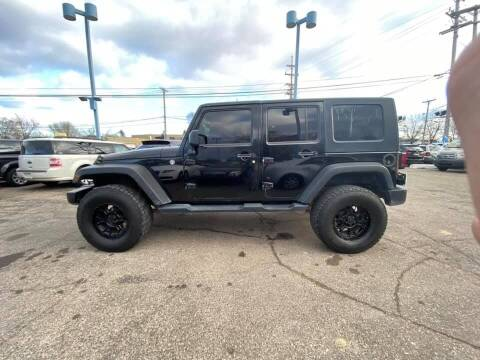 2009 Jeep Wrangler Unlimited for sale at R&R Car Company in Mount Clemens MI