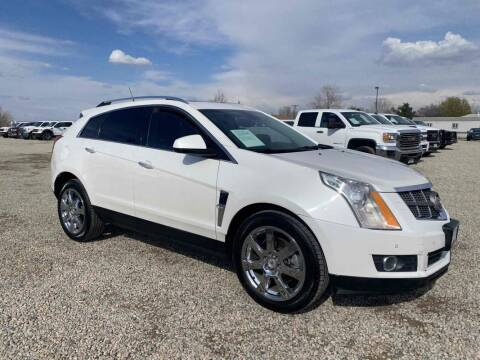 2010 Cadillac SRX for sale at BERKENKOTTER MOTORS in Brighton CO