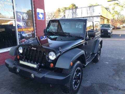 2009 Jeep Wrangler for sale at 4 Girls Auto Sales in Houston TX