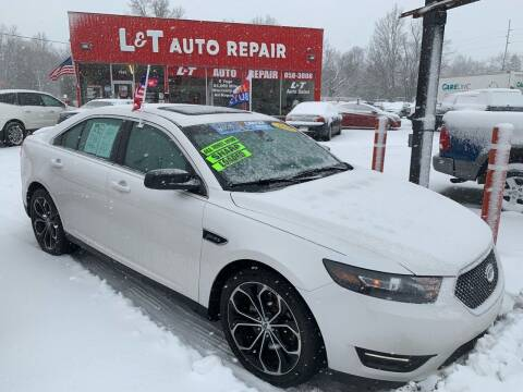 2014 Ford Taurus for sale at L&T Auto Sales in Three Rivers MI