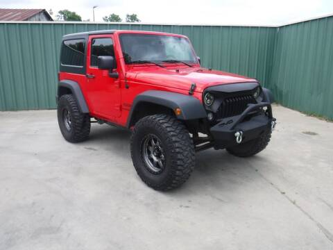 2015 Jeep Wrangler for sale at Triple C Auto Sales in Gainesville TX
