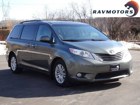 2014 Toyota Sienna for sale at RAVMOTORS in Burnsville MN