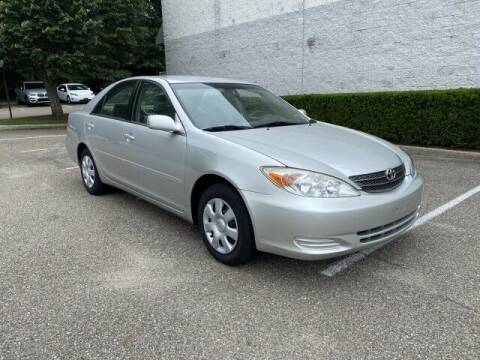 2004 Toyota Camry for sale at Select Auto in Smithtown NY