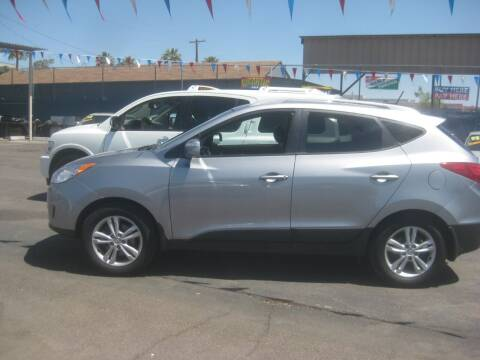 2012 Hyundai Tucson for sale at Town and Country Motors - 1702 East Van Buren Street in Phoenix AZ