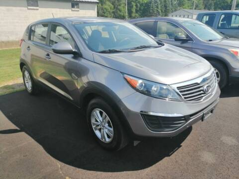 2012 Kia Sportage for sale at KRIS RADIO QUALITY KARS INC in Mansfield OH