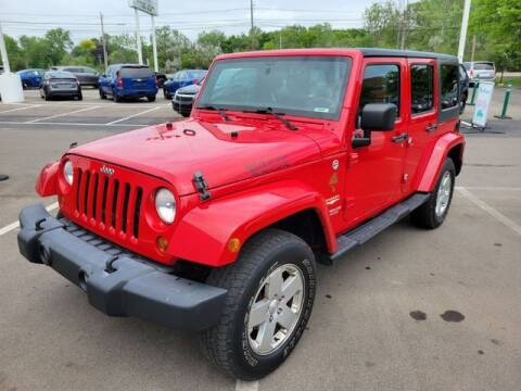 2012 Jeep Wrangler Unlimited for sale at North Oakland Motors in Waterford MI