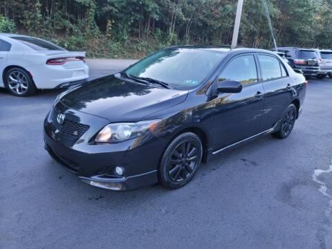 2009 Toyota Corolla for sale at GEORGIA AUTO DEALER, LLC in Buford GA