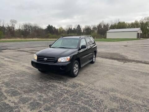 2004 Toyota Highlander for sale at Caruzin Motors in Flint MI