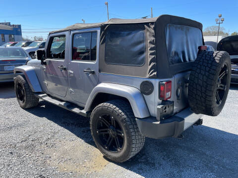 2013 Jeep Wrangler Unlimited for sale at LAURINBURG AUTO SALES in Laurinburg NC