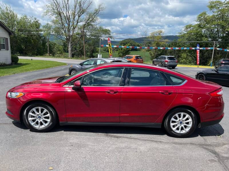 2015 Ford Fusion for sale at MAGNUM MOTORS in Reedsville PA