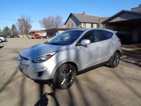 2015 Hyundai Tucson for sale at COUNTRYSIDE AUTO INC in Austin MN