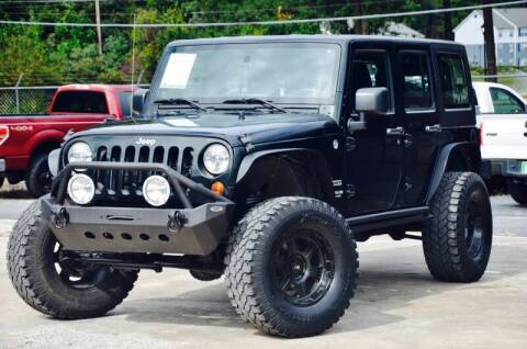 2012 Jeep Wrangler Unlimited for sale at Marietta Auto Mall Center in Marietta GA
