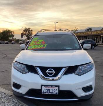 2014 Nissan Rogue for sale at Global Auto Group in Fontana CA