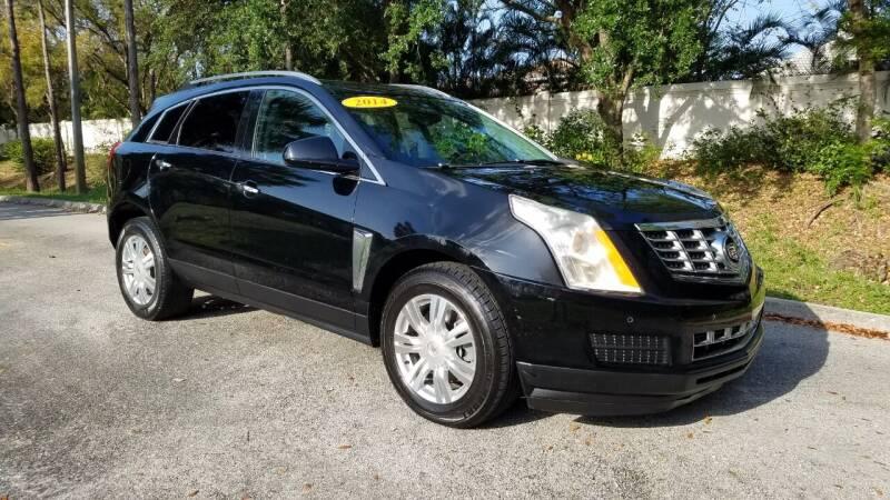 2014 Cadillac SRX for sale at DELRAY AUTO MALL in Delray Beach FL