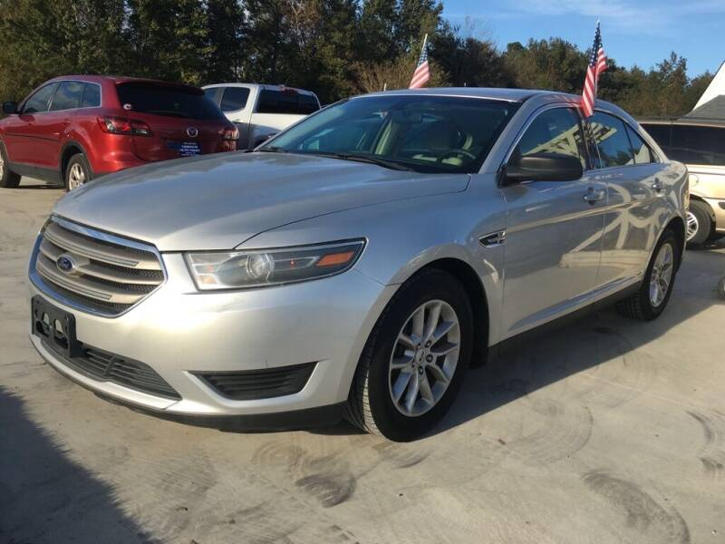 2014 Ford Taurus for sale at Complete Auto Credit in Moyock NC