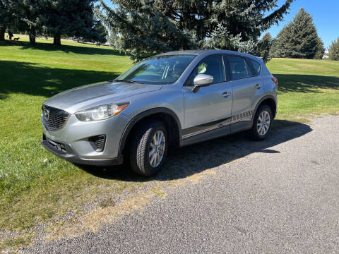 2015 Mazda CX-5 for sale at BELOW BOOK AUTO SALES in Idaho Falls ID
