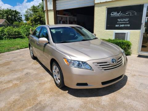 2009 Toyota Camry for sale at O & J Auto Sales in Royal Palm Beach FL